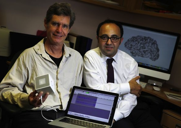 The brain's behind brain stethoscope: Professor Chris Chafe + Dr. Josef Parvizi [Photo: Lea Suzuki, The Chronicle]